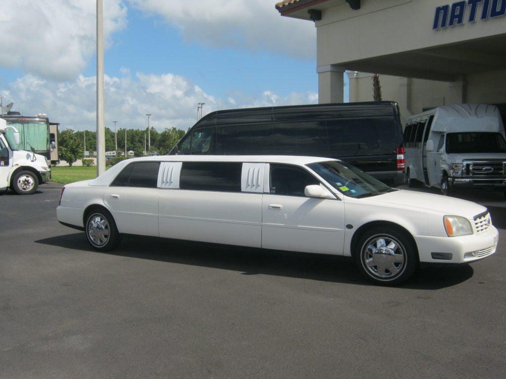 Cadillac Deville 7 passenger charter shuttle coach bus for sale - Gas