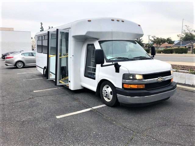 Chevy GMT-610 10 passenger charter shuttle coach bus for sale - Diesel