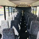 Chevy C5500 28 passenger charter shuttle coach bus for sale - Diesel 6