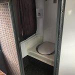 Van Hool 56 passenger charter shuttle coach bus for sale - Diesel 18