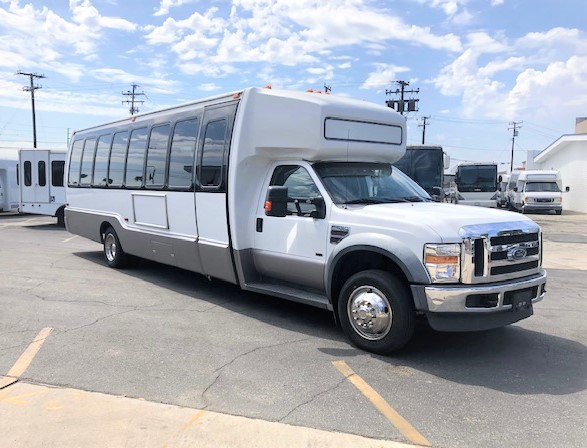 Ford E550 28 passenger charter shuttle coach bus for sale - Diesel
