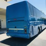 Van Hool 58 passenger charter shuttle coach bus for sale - Diesel 9